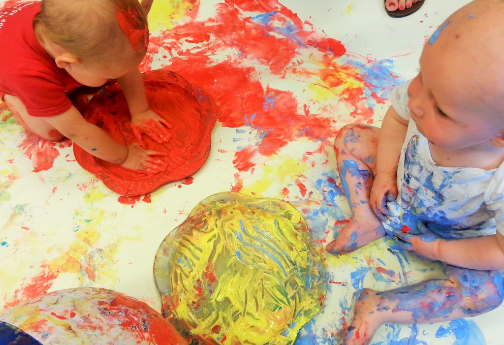 Babies playing with paint