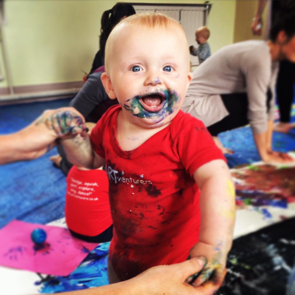 Baby happy in paint